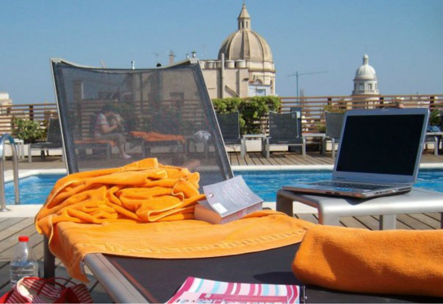 Working as I look over the rooftops of Barcelona, Spain.