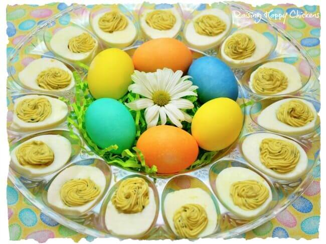 A classic deviled eggs recipe laid out for an Easter themed finger buffet.