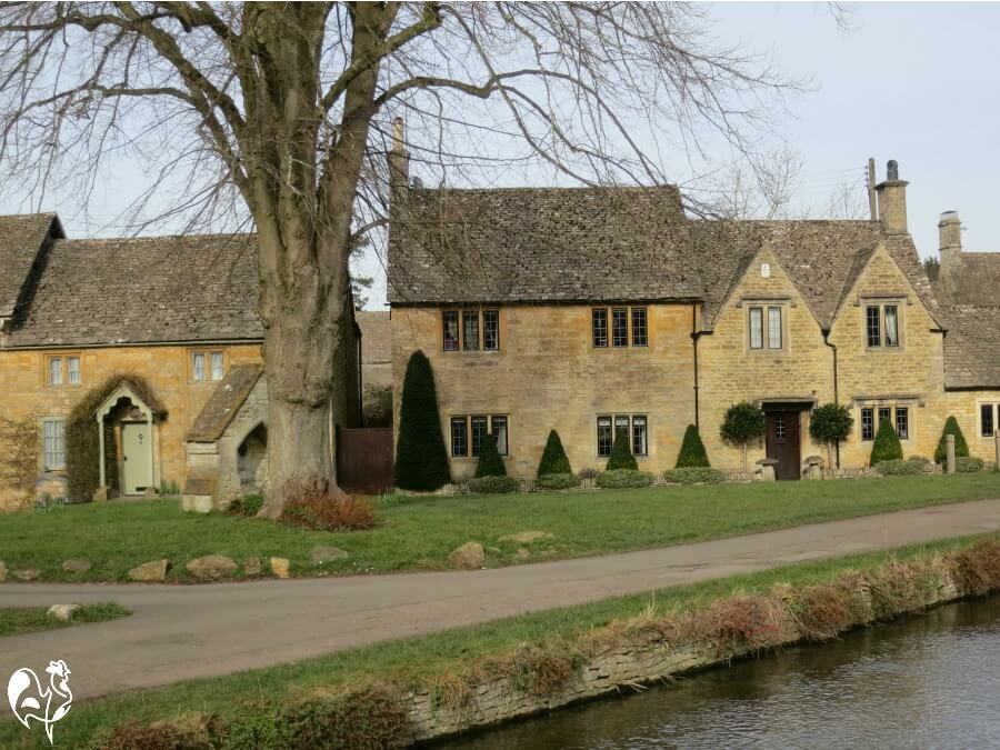 Houses by river in Lower Slaughter, Cotswolds, England.