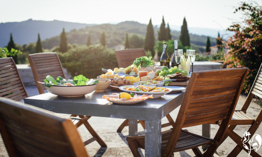 Italian table set for dinner overlooking hills.