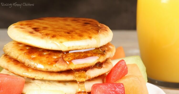 Scotch pancakes with syrup and orange juice.