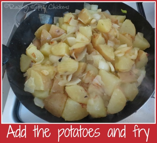 Frying the potatoes and onions together